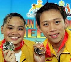 At the Hang Jebat Aquatic Centre yesterday, she won three gold medals for ... - s_50kah