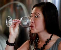 Sandy Hensley, of Denver, sips Lucky 20, a dry white blend duringthe first ... - 20100909__12dcpdinw_500