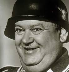 John Banner as Sergeant Schultz