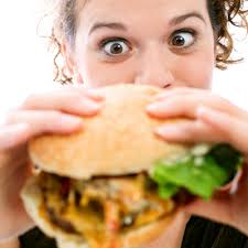 woman eating burger 400 Ten anti female tips to lose weight