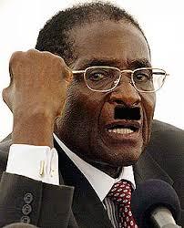 http://tbn0.google.com/images?q=tbn:ZUmdT_yunhObuM:http://dailydespot.files.wordpress.com/2007/05/robert-mugabe-mustache.jpg