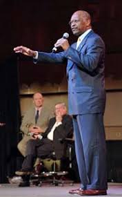 Herman Cain speaking at the