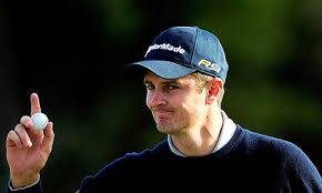 Justin Rose celebrates saving - Justin-Rose-001