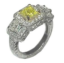 خواتم لا اروع fancy yellow diamond ring 12 new.jpg