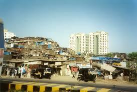 India-Mumbai-aka-Bombay-slums-next-to-high-rise-flats-buggies-1-NC
