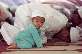 http://tbn0.google.com/images?q=tbn:xLhqDb07zK7eIM:http://www.utexas.edu/cola/depts/mes/islamic/images/boyprayingwithdad.jpg
