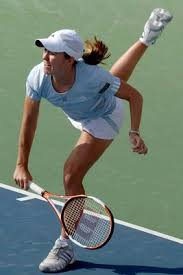 Justine Henin Serving