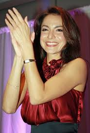 4′s Natalie Solis (pictured) getting hands raised for the auction. - Natalie-Solis-IMG_0049