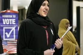 Muslim woman at polls